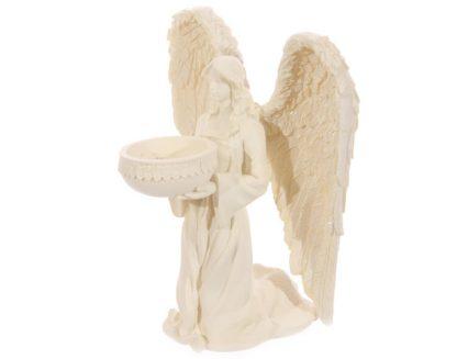 Põlvitava ingliga teeküünlahoidja